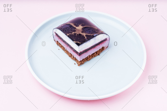 Single slice cake with purple icing