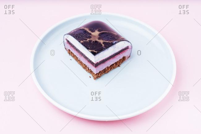 Single slice cake with purple icing