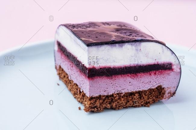 Slice cake with purple icing