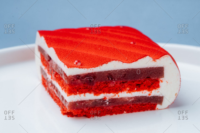 Slice cake with red icing