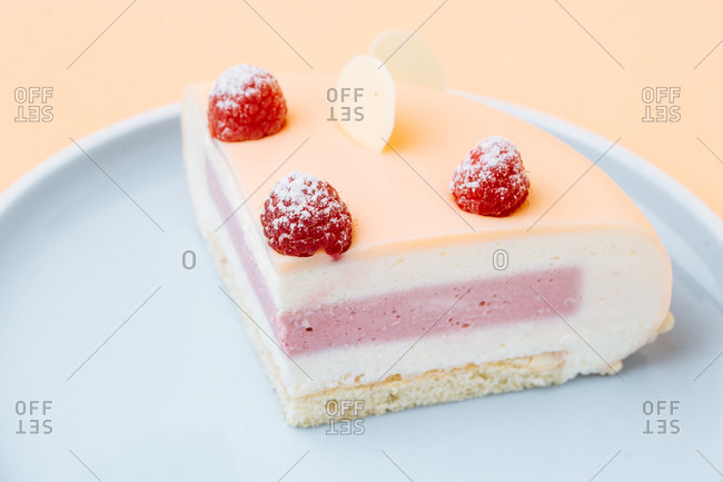 Gourmet dessert topped with raspberries