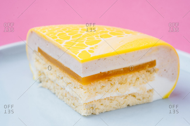 Slice cake with yellow marbleized icing