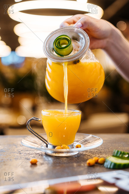 Warm orange juice served in glass at a caf�