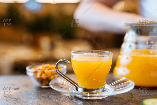 Warm orange juice in glass a cafe