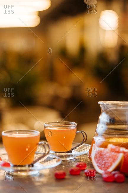 Woman pouring citrus juice