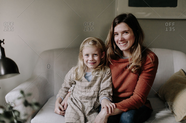 Portrait of mother and daughter sitting together