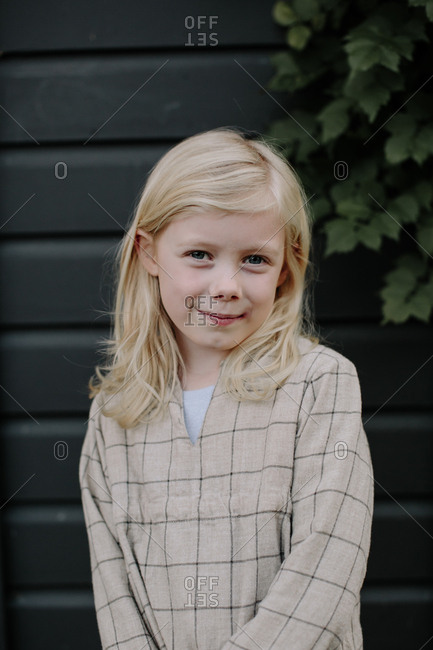 Portrait of young blonde girl outdoors