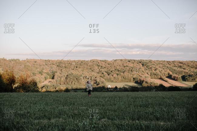 Blonde girl running in field