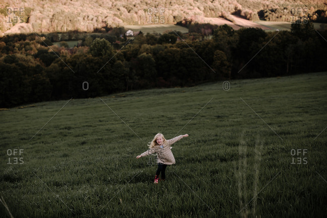 Blonde girl running in the countryside