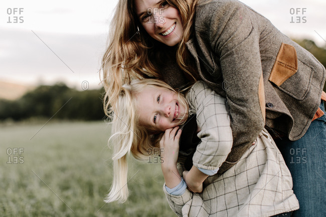 Mom and daughter embraced outdoors