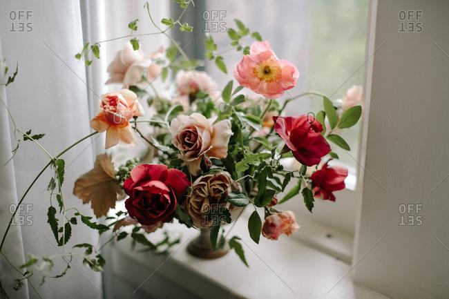 Colorful floral arrangement by window