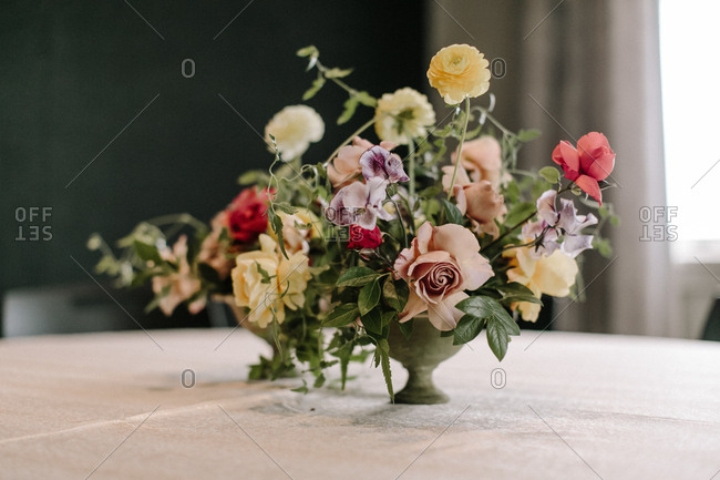 Colorful floral arrangement on table at wedding reception