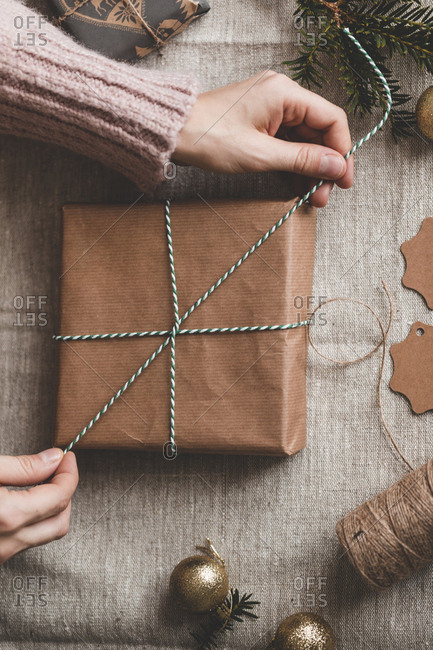 Brown paper package being tied with string
