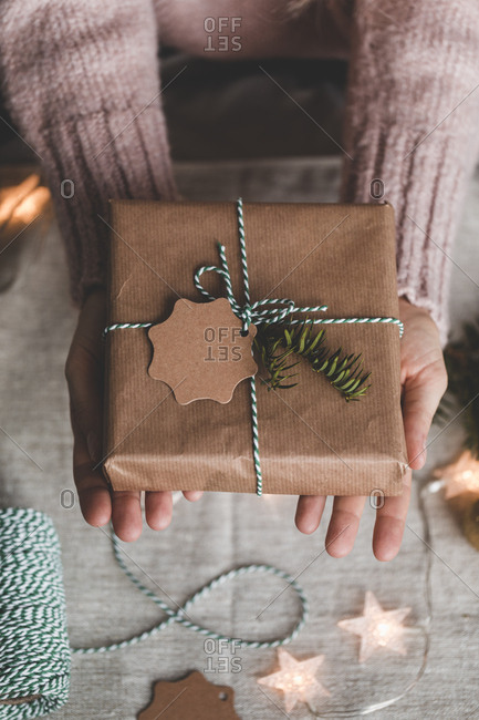Holding a wrapped present