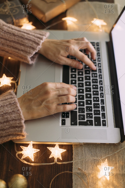 Hands surrounded by illuminated stars typing on a computer