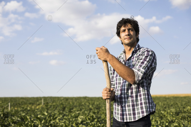 Man in casual outfit standing amidst green plants in beautiful farm field in Salamanca, Spain