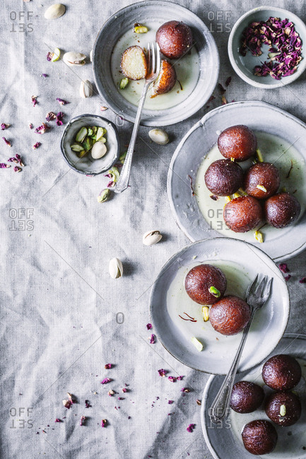 Overhead view of Gulab Jamun, fried dough balls in sugar syrup