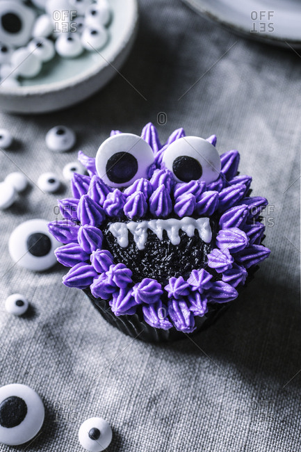 Overhead view of purple monster cupcake