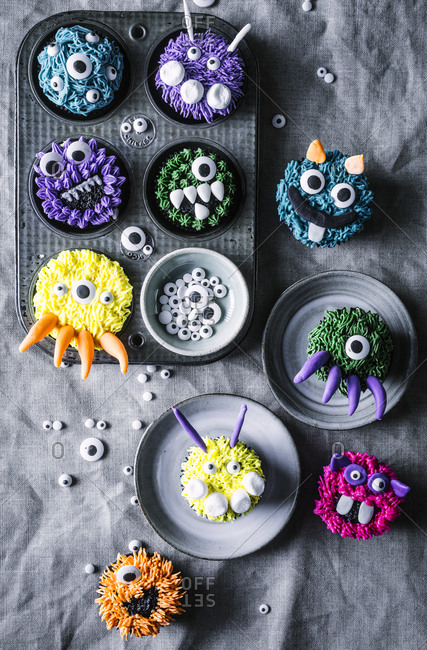 Overhead view of various monster cupcakes