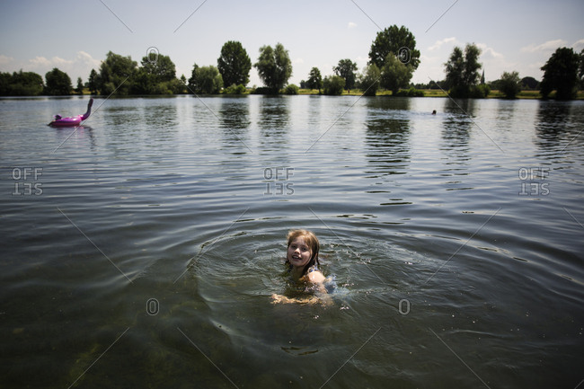 Young girl swimming in a lake