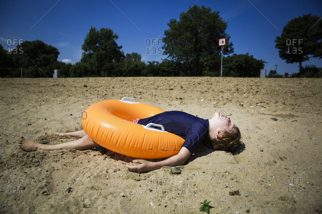 Young boy sleeping on a pool float