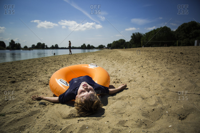 Young boy resting on an innertube