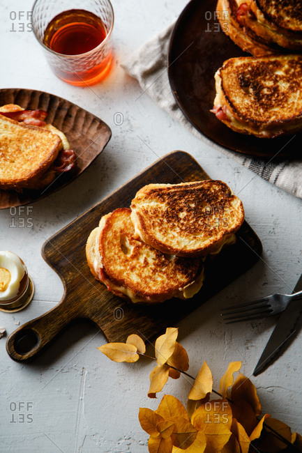 Top view of grilled cheese and bacon sandwiches