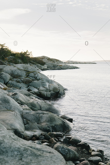 Rocky shoreline in Sweden on an overcast day