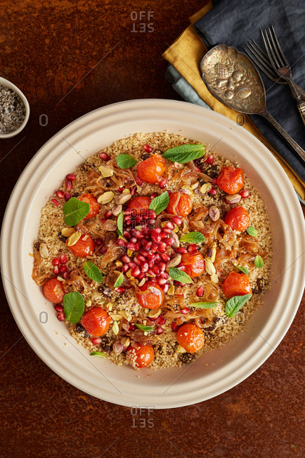 Overhead view of couscous tomato and pomegranate pilaf