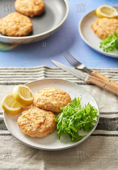 Plate of salmon rosti with arugula