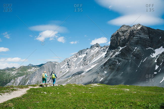 Couple Hiking in the Swiss Alps