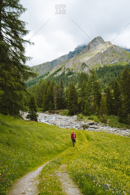 Man hiking in the Swiss Alps