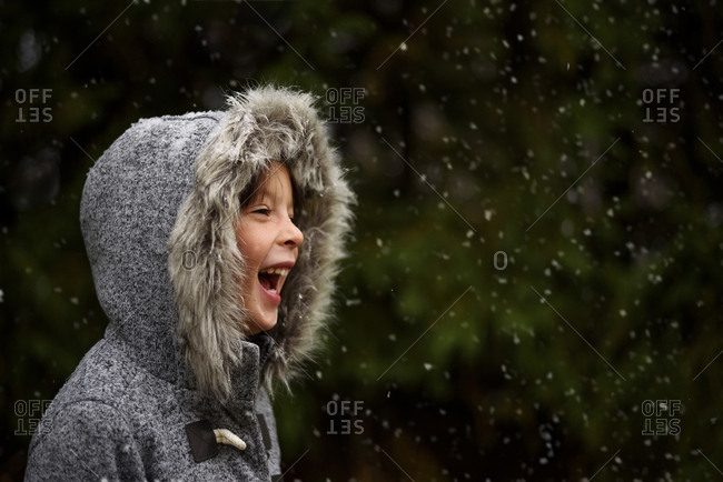 Young girl outside in the first snow fall