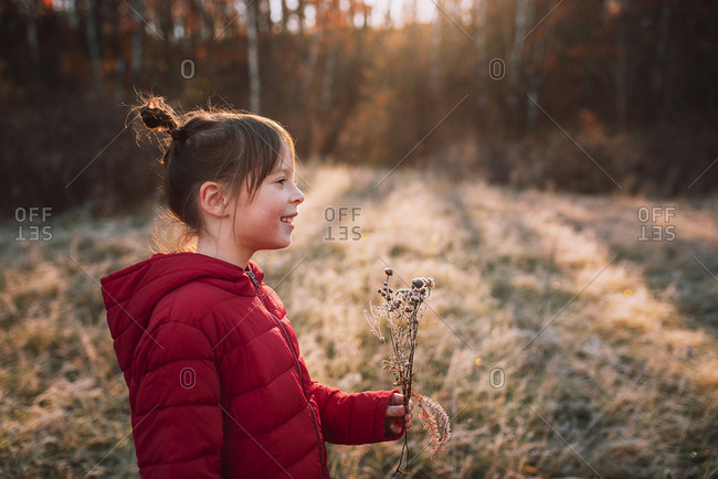 Young girl laughing in a frost covered meadow