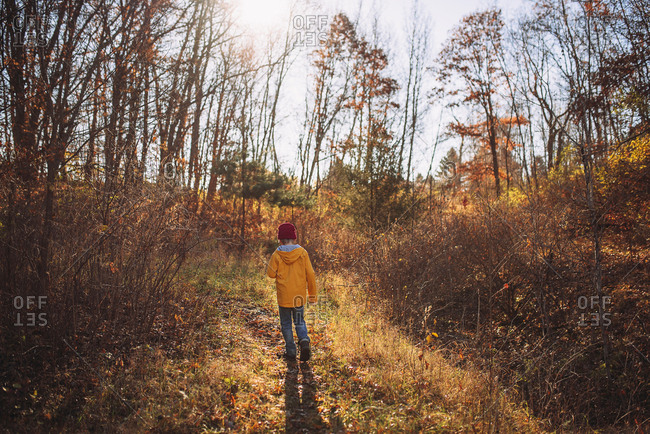 Young boy hiking in the late fall