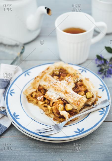 Piece of homemade apple tart on plate