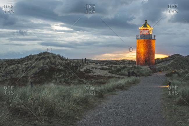 Germany- Schleswig-Holstein- Sylt- Kampen- cross light in dunes at sunset