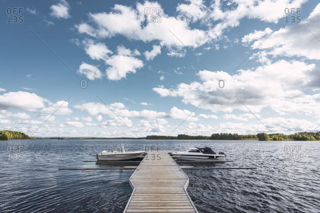 Finland- Jetty with boats in a remote lake
