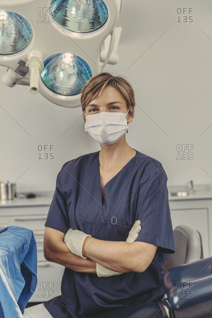 Dental surgeon wearing surgical mask- portrait