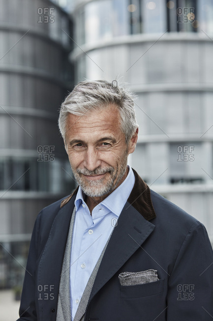 Germany- Duesseldorf- portrait of mature businessman with grey hair and beard outdoors