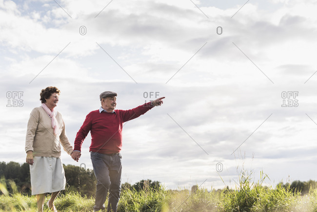 Senior couple on a walk in rural landscape