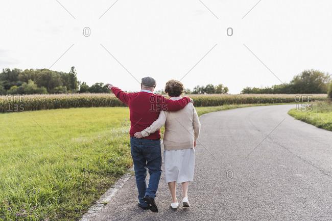 Senior couple on a walk in rural landscape
