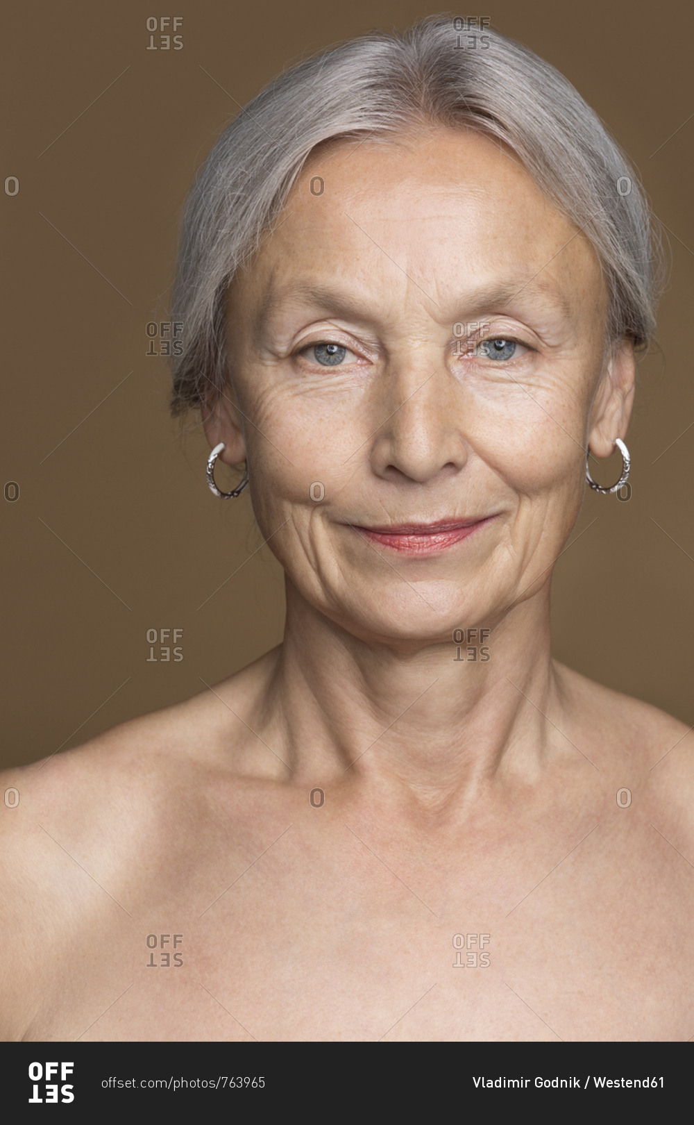 Mature women smiling nude Portrait Of Naked Senior Woman With Grey Hair In Front Of Brown Background Stock Photo Offset
