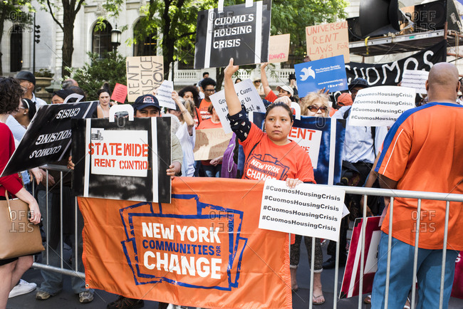New York City, New York, USA - June 14, 2018: Group of people holding signs at rally to end homelessness
