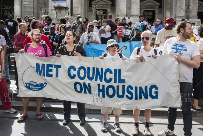 New York City, New York, USA - June 14, 2018: Protestors carrying banner at rally to end homelessness
