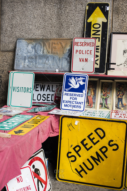 Brooklyn, New York, USA - January 20, 2018: Collectable signs for sale at the Brooklyn Flea market