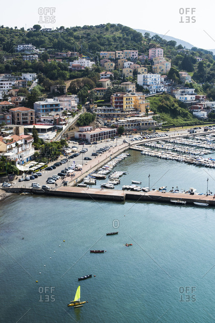 Agropoli, Italy - July 25, 2018: Scenic view of boats in the water along port city on the Cilento Coast in Salerno, Italy