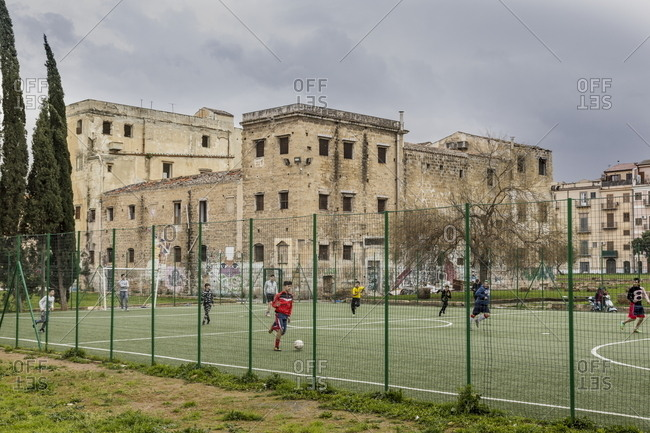 Palermo, Italy - March 7, 2018: Playing football at Piazza Magione in the Kalsa neighborhood