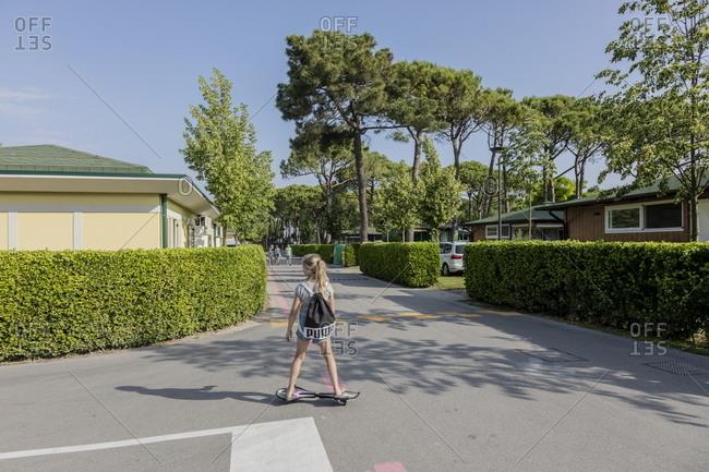 Venice, Italy - May 30, 2018: Girl skateboarding at Marina di Venezia in Punta Sabbioni