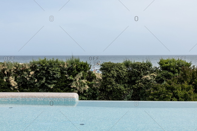 Venice, Italy - May 30, 2018: Infinity pool near the beach at Union Lido luxury resort in Punta Sabbioni